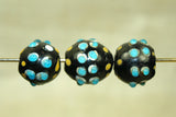 "Venetian black Glass Bead with blue ""eyes"""
