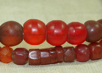 Strand of Antique Ruby and Orange Glass Beads