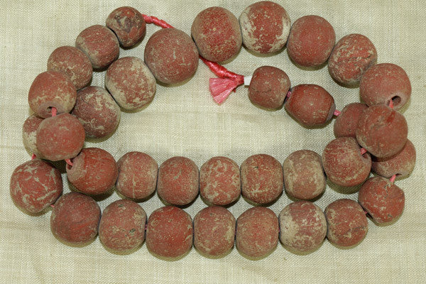 Strand of Medium Brick Red Majapahit Beads