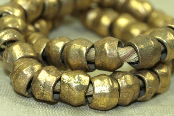 Strand of large rustic 12mm brass bicone beads from asia