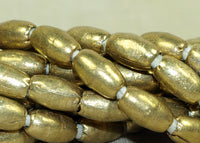 Strand Ethiopian Brass Tapered Football Beads