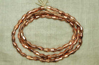 Shiny faceted Copper Bicone Beads from India