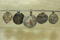 Collection of antique silver sanskrit amulets