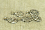 Set of five small silver floral pendants from India