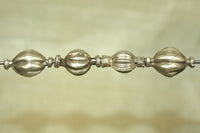 Set of four Antique Fluted Silver Beads
