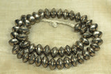 Strand of large Silver saucer beads from Mali