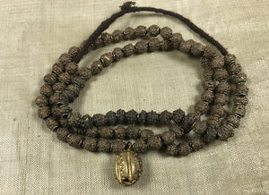 Strand of Yoruba Brass Fabricated Beads with Pendant