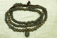 Strand of Yoruba Dark Brass Fabricated Beads