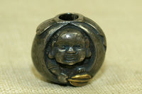 Antique silver bead from Japan featuring the god Hotei
