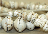 "Strand of Carved Shell ""Bead Caps"" from Mali"