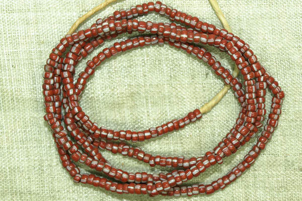 Small Red-Brown Seed beads with white stripes