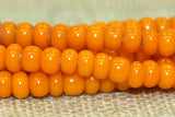 Czech Light opaque orange seed beads, 12º