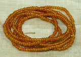 "Transparent ""Dirty"" Orange Seed Beads, 10º"