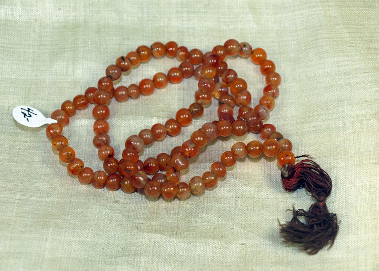 Strand of Hand-Carved 7mm Carnelian Beads from the Lou Zeldis Collection