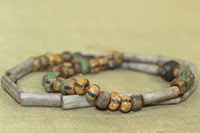 Strand of odd Picasso finished Vintage Czech Beads