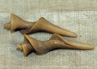Pair of Shell Pendants; Carved Cow Bone; from the Lou Zeldis Studio
