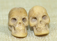 Pair of Small 10mm Hand-Carved Bone Skulls; Lou Zeldis Collection