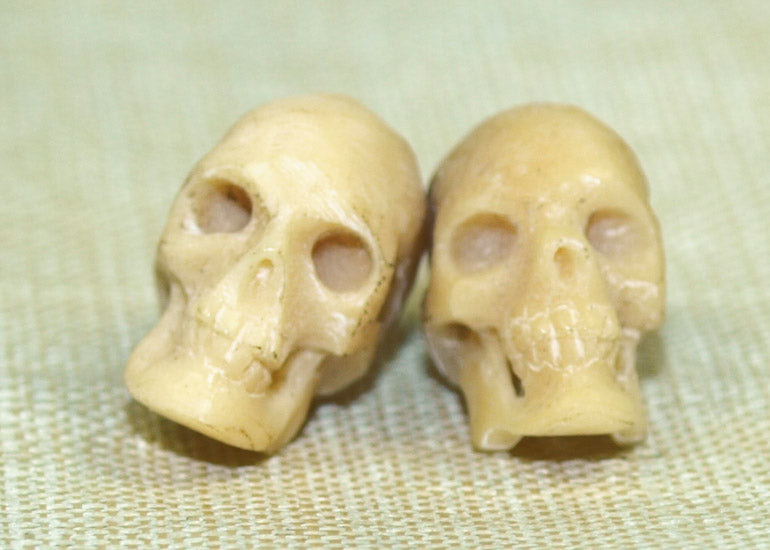 Pair of Small 11mm Hand-Carved Bone Skulls; Lou Zeldis Collection