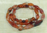 Strand of Assorted Hand-Carved Carnelian Beads from the Lou Zeldis Collection