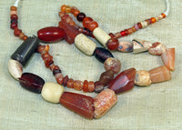 Strand of Small Antique and Old Carnelian Beads from Afghanistan