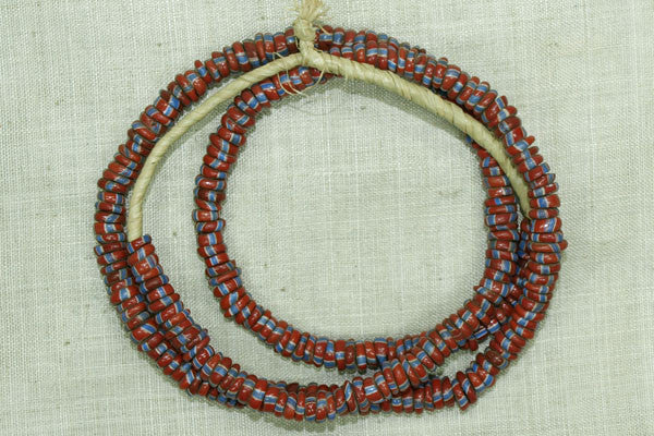 Strand of Brick Red and Blue Eja/Aja Beads