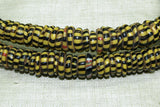 "Strand of ""Antique Yellow"" with Black Stripes Eja (Aja) Beads"