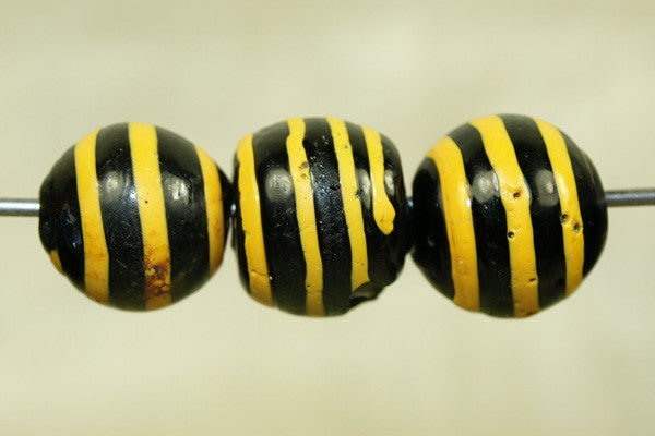 Black Glass Bead with Yellow stripe