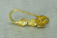 Large gold hook with flower and leaf motif