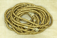 Set of four strands of 4.5mm Smooth Shiny Brass Heishi from Ethiopia