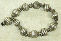 Strand of small Antique Silver Beads from India
