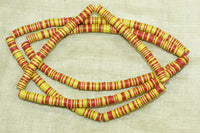 Creamy Yellow, Red, and Black Plastic Disc Beads