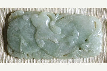 Light green Jade pendant with dog image