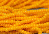 Hank of 16º Bright Yellow-Orange Seed Beads