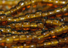 Hank of 16º Dark Topaz Transparent Seed Beads