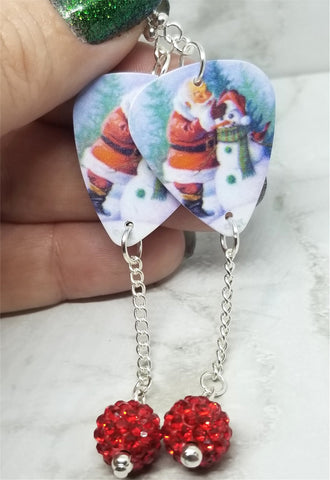 Santa Making a Snowman Scene Guitar Pick Earrings with Red Pave Bead Dangles