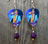 Prince on Stage with His Purple Guitar Earrings with Purple Pave Bead Dangles