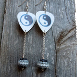 White Yin Yang Guitar Pick Earrings with a Black and White Striped Studded Rhinestone Dangle