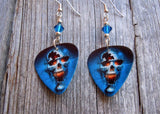Skull on Fire Guitar Pick Earrings with Blue Swarovski Crystals