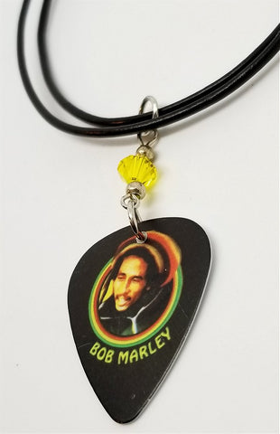 Bob Marley Guitar Pick Necklace with A Yellow Swarovski Crystal on Black Rolled Cord