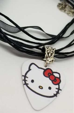 Hello Kitty with a Red Bow Guitar Pick on a Black Ribbon Necklace