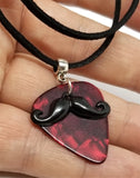 Black Mustache Charm with a Red MOP Guitar Pick on a Black Suede Cord Necklace