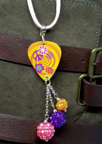 Peace Sign, Flowers, and Mushrooms Guitar Pick on a Pink Suede Cord Necklace with Studded Bead Dangles
