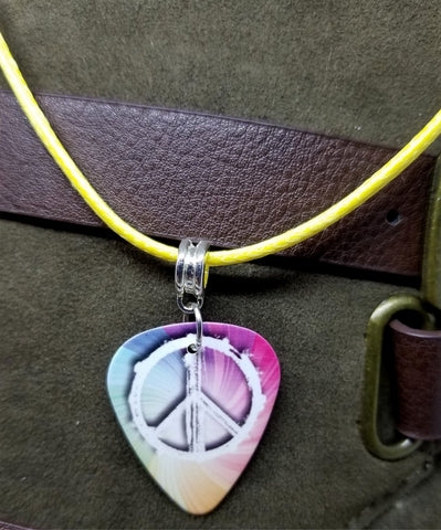 Peace Sign Guitar Pick on a Yellow Rolled Cord Necklace