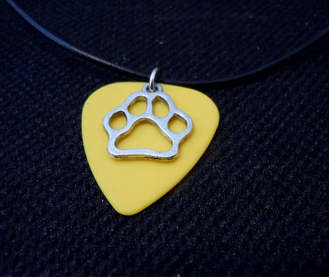 Yellow Guitar Pick with a Paw Print Charm on a Black Rolled Leather Cord Necklace