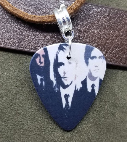 Nirvana Guitar Pick Necklace on Brown Suede Cord