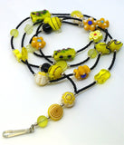 Black Seed Bead Lanyard with Glass and Ceramic Bee and Floral Theme Beads and Magnetic Safety Clasp