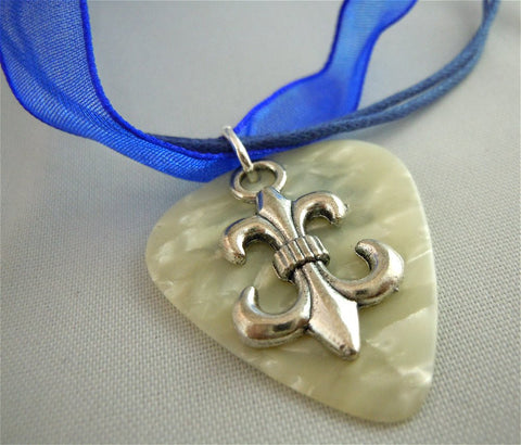 Fleur de Lis Charm with a White MOP Guitar Pick on a Blue Ribbon Necklace