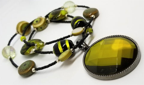 Black Seed Bead Necklace with Green Glass Beads and a Faceted Green Glass Pendant