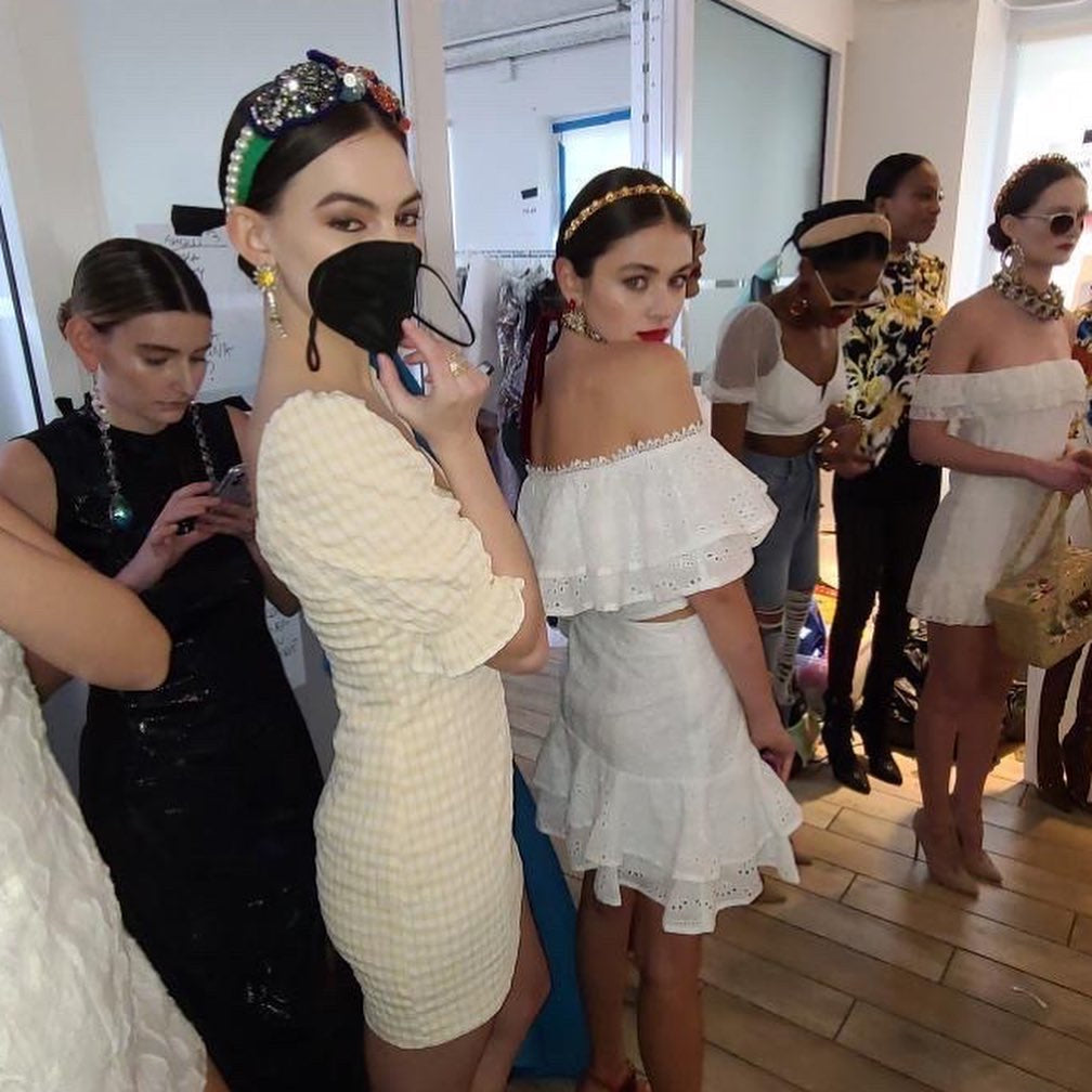 Models lined up before the catwalk, in Jolita Jewellery's pieces for New York Fashion Week