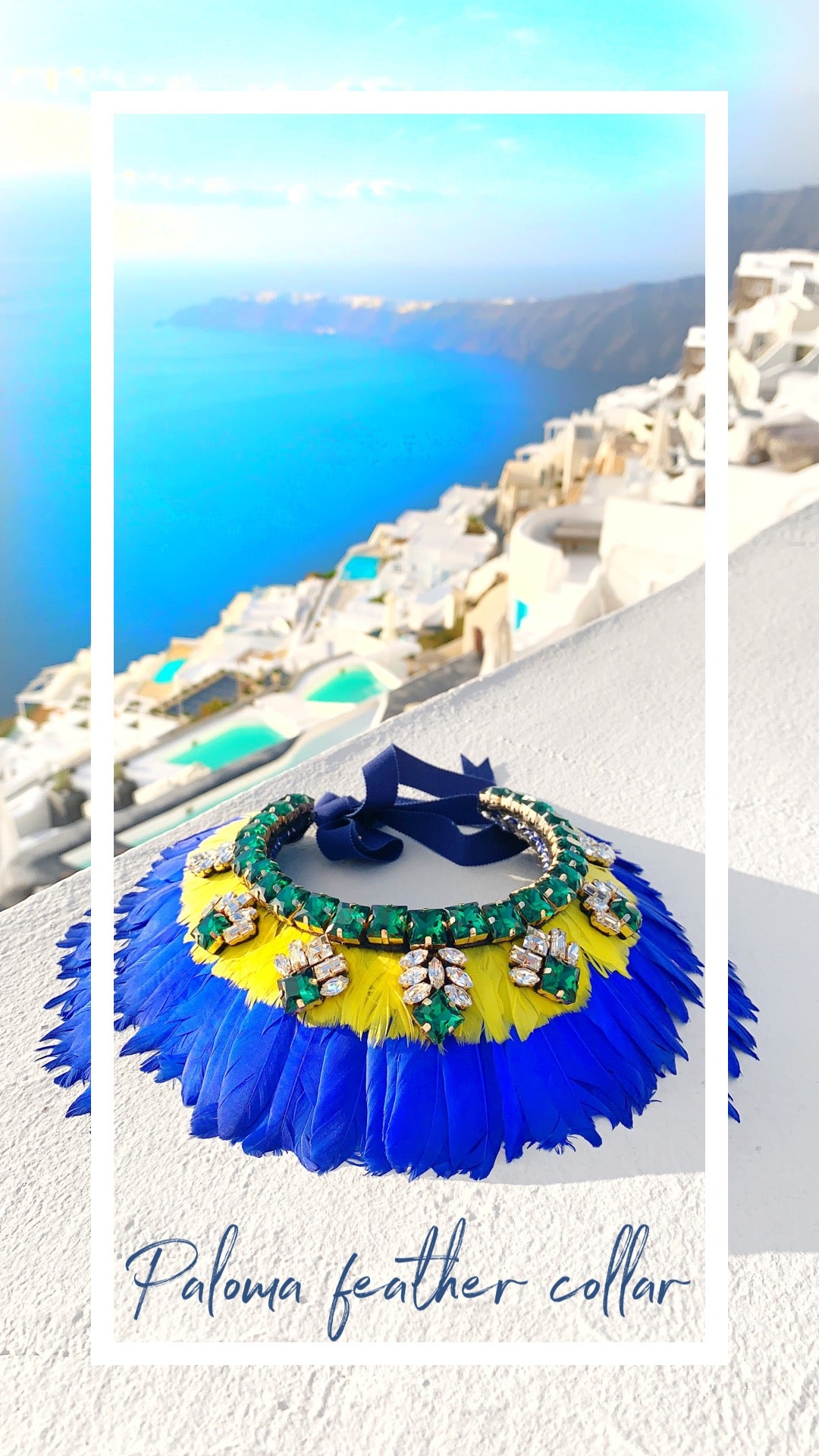 Jolita Jewellery's Paloma crystal and feather collar overlooking Santorini caldera
